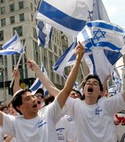 students proudly parade, in  NY, with  which have a Star of David at the center