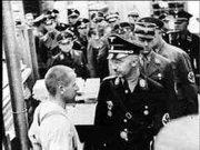 SS Chief Heinrich Himmler (front right, facing prisoner) on a personal visit to the Dachau concentration camp (1936)