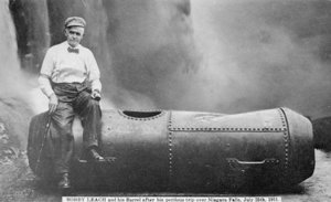 Bobby Leach and his barrel after his trip over Niagara Falls, 1911
