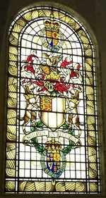 The coat-of-arms of the Royal Society as a stained-glass window.  The motto is 'Nullius in verba'.