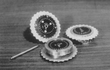 Three Enigma rotors and the shaft on which they are placed when in use.