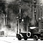 A Rolls Royce armoured car in action in street fighting on 's  during the