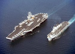 Two aircraft carriers,  (left), and  (right), showing the difference in size between a  and a light  aircraft carrier.