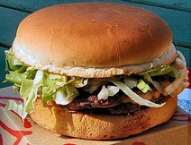 Hamburgers often contain lettuce, onions, and other toppings, as shown here.