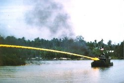 Riverboat of the U.S. brownwater navy deploying napalm during the