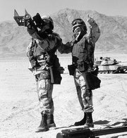 Two soldiers preparing to fire a shoulder-mounted Stinger missile launcher