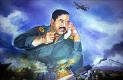 Saddam Hussein in a  picture overseeing a war scene in the foreground